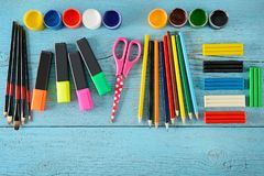 School supplies scissors, paints, modelling clay, markers, penc stock images