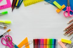 School supplies on sheet in a ruler background . Top view stock images