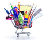 School supplies in shopping cart. Back to school Royalty Free Stock Photo