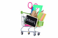 School supplies. Shopping cart with school supplies isolated on a white Stock Photo
