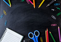 School supplies side border on a chalkboard background. School s. Upplies on blackboard background. back to school, education concept stock images