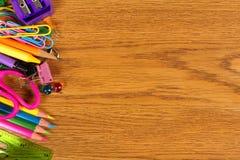 School Supplies Side Border On Wood Desk Royalty Free Stock Photos