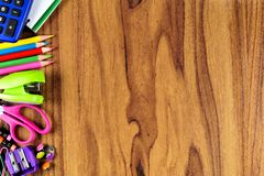 School supplies side border on wood desk background Stock Image