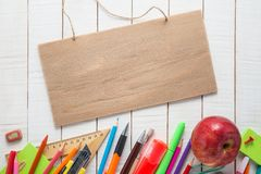 School supplies, signboard and apple Royalty Free Stock Photography