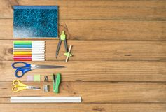 School supplies on some wooden boards. Concept of back to school. School supplies on some wooden boards stock photography