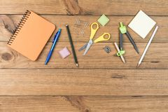 School supplies on some wooden boards. Concept of back to school. School supplies on some wooden boards stock photo