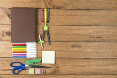 School supplies on some wooden boards. Concept of back to school. School supplies on some wooden boards royalty free stock photo