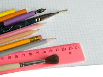 School supplies on squared sheet Royalty Free Stock Photo