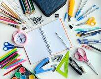 School supplies, stationery shot from above, mockup in a circle with copy space in the center