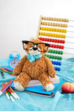 School supplies. Teddy bear with glasses Stock Photography