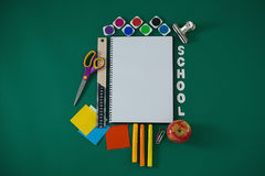 School supplies with text arranged on green background. Overhead view of school supplies with text arranged on green background Royalty Free Stock Images