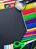 School supplies to the chalkboard Royalty Free Stock Images