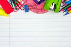 School supplies top border on lined paper background Stock Photography