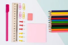 School supplies. Top view photo of stickers, paper clips and pin. S, ruler, rubber on white background royalty free stock photo