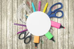 School supplies under an empty paper Royalty Free Stock Photo