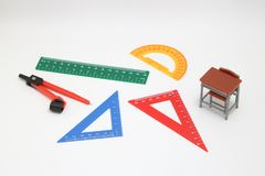 School supplies used in math class, geometry or science.  Mathematics geometry tool for student in math class on white background. School supplies used in math Stock Photo