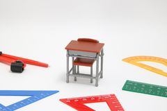 School supplies used in math class, geometry or science.  Mathematics geometry tool for student in math class on white background. School supplies used in math Stock Photos