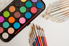 School supplies watercolor and brushes Stock Photography