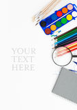 School supplies. White background with coloured school supplies Royalty Free Stock Photos