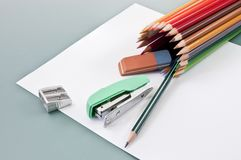 School supplies on a white paper. Outgoing of colored pencils tube stock photos