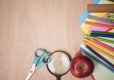 School supplies on wood table background. empty copy space stock photos