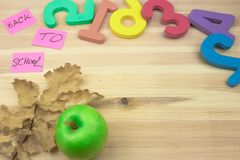 School supplies on wooden background stock photography