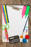 School supplies on the wooden background Royalty Free Stock Photos