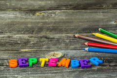 School supplies on wooden background, Notepad pencils with the word September Stock Images