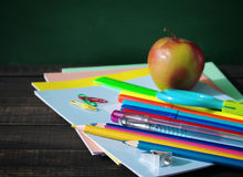 School supplies on a wooden old surface. Royalty Free Stock Image