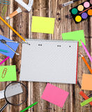 School supplies on wooden table Stock Image