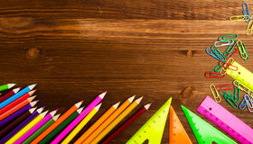 School supplies & x28;pencil, pen, ruler, triangle& x29; on blackboard bac Royalty Free Stock Images