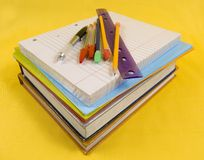 School Supplies on yellow background. With pen, pencils, rulers, paper and folders royalty free stock photography