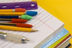 School Supplies on yellow background. With pen, pencils, rulers, paper and folders royalty free stock photo