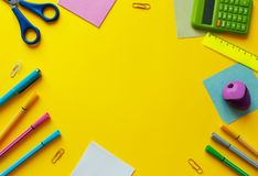 School supplies on yellow background. Back to school concept with space for text. Top view. Copy space. School office supplies. royalty free stock photo
