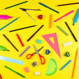 School supplies on yellow background stock photography