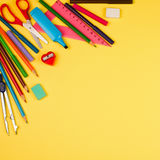 School supplies on yellow background royalty free stock image