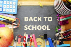 School supply on small blackboard with back to school words Royalty Free Stock Images