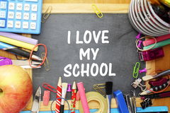 School supply on small blackboard with i love my school words Royalty Free Stock Images