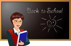 School Teacher. Teacher in the front of blackboard Stock Image