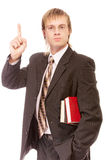 School teacher with books lifts finger upwards Royalty Free Stock Photos