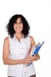 School teacher holding books. Stock Photo