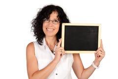 School teacher holding chalkboard. Royalty Free Stock Images