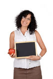 School teacher holding chalkboard. Stock Images