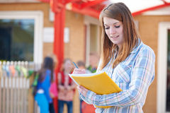 School Teacher Making Notes In Playground Royalty Free Stock Photo