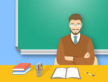 School teacher man at the desk flat education illustration. School teacher at desk flat education vector illustration. Young attractive smiling man teacher Stock Photos