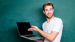 School teacher programming with laptop. Student learn programming language. Programming web development. Handsome man. Use modern technology. Digital technology royalty free stock images