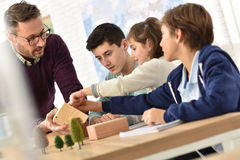 School teacher with pupils in biology class Royalty Free Stock Photography