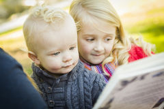 School Teacher Reading a Book to Two Adorable Blonde Children Royalty Free Stock Photo