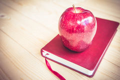 School teacher's desk with books and apple Royalty Free Stock Photos