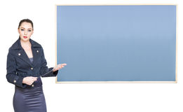 School Teacher Standing Next To Blank Blackboard Stock Images